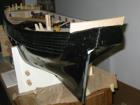 The transom piece was pinned in place with a slight overlap, and then sanded to fit.