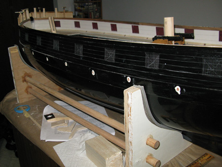 Prepping the hull for a good glue bond.