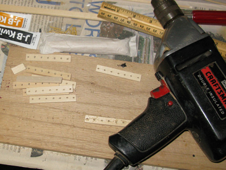 Leftover plank wood became the pin racks.