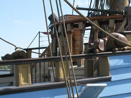 Kalmar Nyckel's watchdogs.  Eyes open to sea, closed facing in.