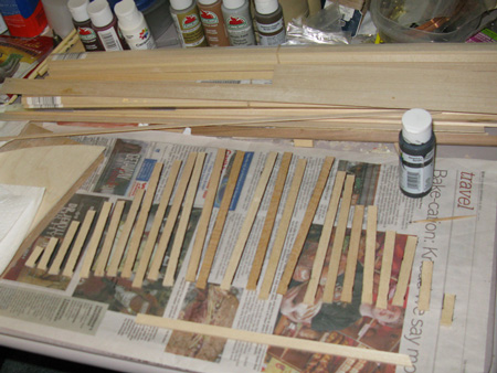 Painting the forecastle planks black to give a little more highlight.